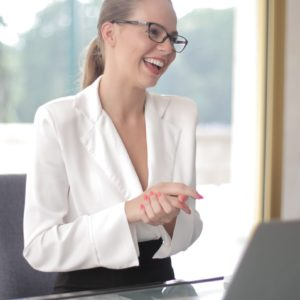 Canva - Smiling businesswoman with laptop in office CROPPED